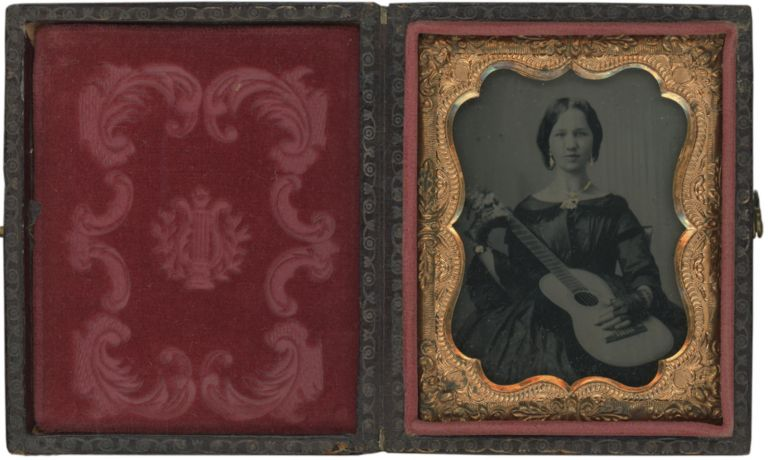 Ninth Plate Cased Ambrotype of a Woman Holding a Guitar. Photography - 19th Century, Vernacular.
