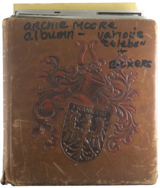 Personal Scrapbook belonging to Archie Moore showing Moore's Travels in Germany and Africa,...