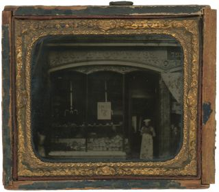 Sixth Plate Tintype of an Asian-American Posed in Front of a Bakery, c. 1870s-1880s....